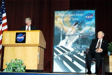 KENNEDY SPACE CENTER, FLA. - KSC Deputy Director James W. Kennedy addresses a group of KSC employees assembled in the KSC Training Auditorium, as KSC Director Roy D. Bridges looks on (right). The occasion is the announcement of Kennedy as the next director of the NASA Kennedy Space Center (KSC) in Florida. Kennedy has served as KSC's deputy director since November 2002. He will succeed Bridges, who was appointed on June 13 to lead NASA's Langley Research Center, Hampton, Va.