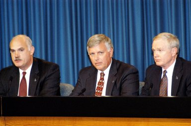 KENNEDY SPACE CENTER, FLA. - NASA officials participate in a press conference in KSC's Press Site Auditorium. From left are NASA Associate Administrator for Space Flight William F. Readdy, KSC Deputy Director James W. Kennedy, and KSC Director Roy D. Bridges. The press conference followed the official announcement of Kennedy as the next director of the NASA Kennedy Space Center (KSC) in Florida. Kennedy has served as KSC's deputy director since November 2002. He will succeed Bridges, who was appointed on June 13 to lead NASA's Langley Research Center, Hampton, Va.