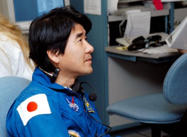 """KENNEDY SPACE CENTER, FLA. - Takao Doi, an astronaut with the National Space Development Agency of Japan (NASDA), watches the sensors during a Multi-Equipment Interface Test (MEIT) on the Japanese Experiment Module (JEM). NASDA developed the laboratory at the Tsukuba Space Center near Tokyo. It is the first element, named """"Kibo"""" (Hope), to be delivered to KSC. The JEM is Japan's primary contribution to the Station. It will enhance the unique research capabilities of the orbiting complex by providing an additional environment for astronauts to conduct science experiments."""