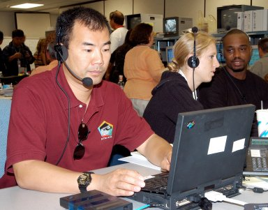 KENNEDY SPACE CENTER, FLA. - Astronaut Soichi Noguchi, with the National Space Development Agency of Japan (NASDA), works at a console during a Multi-Element Integrated Test (MEIT) of the U.S. Node 2 and the Japanese Experiment Module (JEM). Noguchi is assigned to mission STS-114 as a mission specialist. Node 2 attaches to the end of the U.S. Lab on the ISS and provides attach locations for the Japanese laboratory, European laboratory, the Centrifuge Accommodation Module and, eventually, Multipurpose Logistics Modules. It will provide the primary docking location for the Shuttle when a pressurized mating adapter is attached to Node 2. Installation of the module will complete the U.S. Core of the ISS. The JEM, developed by NASDA, is Japan's primary contribution to the Station. It will enhance the unique research capabilities of the orbiting complex by providing an additional environment for astronauts to conduct science experiments.