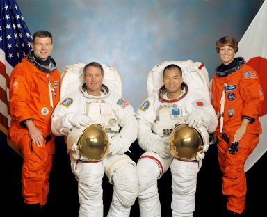 JOHNSON SPACE CENTER, HOUSTON, TEXAS -- (STS114-S-002) -- These four astronauts are in training for the STS-114 mission. Astronauts Eileen M. Collins, mission commander, and James M. Kelly, pilot, flank the two mission specialists -- astronauts Stephen K. Robinson (second from left) and Soichi Noguchi -- who are assigned to spacewalk duty to perform work on the International Space Station. Noguchi represents the Japanese Space agency.