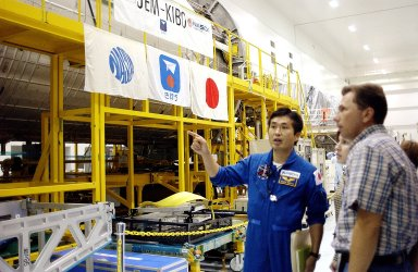 KENNEDY SPACE CENTER, FLA. - In the Space Station Processing Facility, Japanese astronaut Koichi Wakata looks over the Pressurized Module, or PM, part of the Japanese Experiment Module (JEM). The PM provides a shirt-sleeve environment in which astronauts on the International Space Station can conduct microgravity experiments. There are a total of 23 racks, including 10 experiment racks, inside the PM providing a power supply, communications, air conditioning, hardware cooling, water control and experiment support functions.