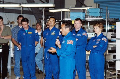 KENNEDY SPACE CENTER, FLA. - STS-114 Mission Specialist Charles Camarda talks to workers in the Orbiter Processing Facility. Behind him (left to right) are other crew members: Mission Specialists Stephen Robinson and Soichi Noguchi, Pilot James Kelly and Commander Eileen Collins. Camarda is a new addition to the crew. Noguchi is with the Japan Aerospace Exploration Agency, JAXA. The STS-114 crew is at KSC to take part in crew equipment and orbiter familiarization.
