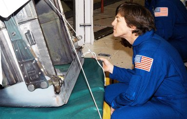 KENNEDY SPACE CENTER, FLA. - In the Orbiter Processing Facility, STS-114 Mission Specialist Wendy Lawrence looks at an reinforced carbon-carbon panel ready to be installed on Atlantis. Lawrence is a new addition to the mission crew, who are at KSC to take part in crew equipment and orbiter familiarization.