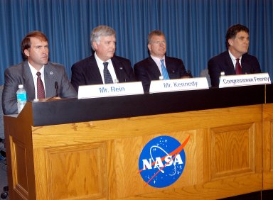 KENNEDY SPACE CENTER, FLA. -- Mike Rein (at left), division chief of KSC External Affairs, moderates the press conference featuring (second from left to right) U.S. Rep. Tom Feeney, Center Director Jim Kennedy and U.S. Rep. Dave Weldon. The media were interested in hearing Kennedy?s and the congressmen?s reactions to the new mission for NASA outlined by President George W. Bush Jan. 14.
