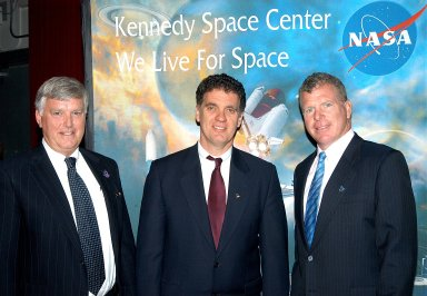 KENNEDY SPACE CENTER, FLA. --After a Town Hall meeting at KSC, Center Director Jim Kennedy and U.S. Reps. Dave Weldon and Tom Feeney pause for a photo before heading to the NASA-KSC News Center for a press conference. Weldon and Feeney discussed the new mission for NASA outlined by President George W. Bush Jan. 14. The congressmen and Kennedy also answered questions from employees in the audience.