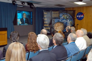 KENNEDY SPACE CENTER, FLA. -- KSC management and other employees gather in the Center?s television studio to watch the address by President George W. Bush from NASA Headquarters stating his goals for NASA?s new mission. Seated in the front row, left to right, are Ken Aguilar, chief, Equal Opportunity office; Lisa Malone, director of External Affairs; Bruce Buckingham, assistant to Dr. Woodrow Whitlow, KSC deputy director; Dr. Whitlow; Shannon Roberts, with External Affairs; Howard DeCastro, vice president and Space Shuttle program manager, United Space Alliance; and Bill Pickavance vice president and associate program manager of Florida Operations, USA. The President?s goals are completing the International Space Station, retiring the Space Shuttle orbiters, developing a new crew exploration vehicle, and returning to the moon and beyond within the next two decades. Pres. Bush was welcomed by NASA Administrator Sean O?Keefe and Expedition 8 Commander Michael Foale, who greeted him from the International Space Station. Members of the Washington, D.C., audience included astronauts Eileen Collins, Ed Lu and Michael Lopez-Alegria, and former astronaut Gene Cernan.