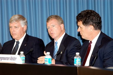 KENNEDY SPACE CENTER, FLA. -- At a press conference, U.S. Rep. Tom Feeney responds to a question from a reporter about the new mission for NASA outlined by President George W. Bush Jan. 14. Present with Feeney are Center Director Jim Kennedy (left) and U.S. Rep. Dave Weldon (right).