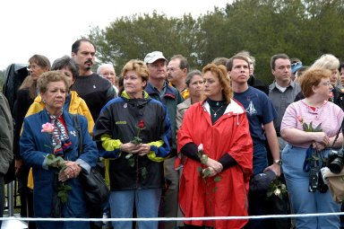 KENNEDY SPACE CENTER, FLA. - Friends, co-workers and families gather at the Space Memorial Mirror for KSC?s special service remembering and honoring the crew of Columbia. Feb. 1 is the one-year anniversary of the loss of the crew and orbiter Columbia in a tragic accident as the ship returned to Earth following mission STS-107. The public was invited to the memorial service held at the KSC Visitor Complex. Participants included Center Director Jim Kennedy, Deputy Director Woodrow Whitlow Jr., Executive Director of Florida Space Authority Winston Scott, Dr. Stephen Feldman, president of the Astronaut Memorial Foundation, and dancers from the Shoshone-Bannock Native American community in Fort Hall, Idaho.