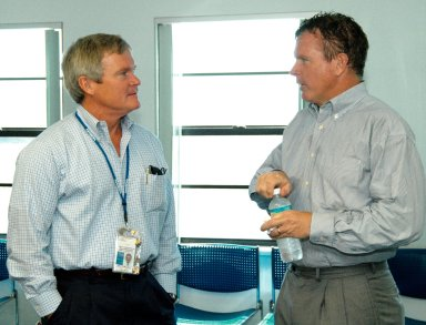 KENNEDY SPACE CENTER, FLA. - At the Beach House, Congressman Tom Feeney (right) talks with Bruce Melnick (left), vice president for Boeing Florida Operations at KSC. Feeney conducted a walk down the coastline of Florida?s 24th District on several days during January and February, concluding March 1 at Kennedy Space Center. On his walks, Feeney met with constituents and community leaders to discuss legislative issues that will be addressed by the 108th Congress.
