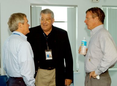 KENNEDY SPACE CENTER, FLA. - At the Beach House, Congressman Tom Feeney (right) talks with Bruce Melnick (left), vice president for Boeing Florida Operations at KSC, and Bill Pickavance, vice president, associate program manager of Florida Operations, United Space Alliance. During January and February, Congressman Feeney traveled the entire coastline of Florida?s 24th District, and concluded his walks March 1 in Brevard County. On his walks, he met with constituents and community leaders to discuss legislative issues that will be addressed by the 108th Congress.
