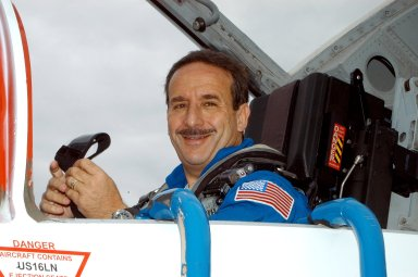 KENNEDY SPACE CENTER, FLA. - STS-114 Mission Specialist Charles Camarda arrives at KSC aboard a T-38 jet aircraft. He and other crew members are at the Center for familiarization activities with equipment. The mission is Logistics Flight 1, scheduled to deliver the Multi-Purpose Logistics Module carrying supplies and equipment,to the Space Station, and the external stowage platform.