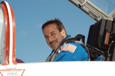 KENNEDY SPACE CENTER, FLA. - On the KSC Shuttle Landing Facility, STS-114 Mission Specialist Charles Camarda waits in a T-38 jet aircraft for his return to Houston. Crew members were at KSC for Shuttle and mission equipment familiarization. The STS-114 mission is Logistics Flight 1, which is scheduled to deliver supplies and equipment, plus the external stowage platform, to the International Space Station.