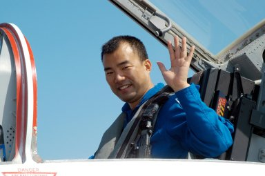 KENNEDY SPACE CENTER, FLA. - STS-114 Mission Specialist Soichi Noguchi waves before departing KSC in a T-38 jet aircraft to return to Houston. Crew members were at KSC for Shuttle and mission equipment familiarization. Noguchi represents the Japanese Aerospace and Exploration Agency. The STS-114 mission is Logistics Flight 1, which is scheduled to deliver supplies and equipment, plus the external stowage platform, to the International Space Station.