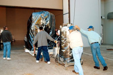 KENNEDY SPACE CENTER, FLA. - At the Astrotech Space Operations processing facilities near KSC, workers begin moving NASA?s MESSENGER spacecraft into the building MESSENGER - short for MErcury Surface, Space ENvironment, GEochemistry and Ranging - is being taken into a high bay clean room where employees of the Johns Hopkins University Applied Physics Laboratory, builders of the spacecraft, will perform an initial state-of-health check. Then processing for launch can begin, including checkout of the power systems, communications systems and control systems. The thermal blankets will also be attached for flight. MESSENGER will be launched May 11 on a six-year mission aboard a Boeing Delta II rocket. Liftoff is targeted for 2:26 a.m. EDT on Tuesday, May 11.