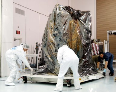 KENNEDY SPACE CENTER, FLA. - At the Astrotech Space Operations processing facilities near KSC, workers move NASA?s MESSENGER spacecraft into a high bay clean room. Employees of the Johns Hopkins University Applied Physics Laboratory, builders of the spacecraft, will perform an initial state-of-health check. Then processing for launch can begin, including checkout of the power systems, communications systems and control systems. The thermal blankets will also be attached for flight. MESSENGER - short for MErcury Surface, Space ENvironment, GEochemistry and Ranging - will be launched May 11 on a six-year mission aboard a Boeing Delta II rocket. Liftoff is targeted for 2:26 a.m. EDT on Tuesday, May 11.