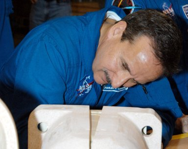 KENNEDY SPACE CENTER, FLA. - In the SRB Assembly and Refurbishment Facility, STS-114 Mission Specialist Charles Camarda looks closely at a test design of the bolt catcher insulation. The STS-114 crew is at KSC for familiarization with Shuttle and mission equipment. The mission is Logistics Flight 1, which is scheduled to deliver supplies and equipment, plus the external stowage platform, to the International Space Station.