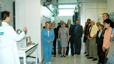 KENNEDY SPACE CENTER, FLA. -- A Dynamac worker (left) explains the function of the KSC Space Life Sciences (SLS) Lab to a prestigious tour group: in the center, Laura O?Keefe and NASA Administrator Sean O?Keefe; at right, Florida Gov. Jeb Bush flanked by his wife, Columba on the left and Bernadette Kennedy, wife of Center Director Jim Kennedy. The new lab is a state-of-the-art facility built for ISS biotechnology research. It was developed as a partnership between NASA-KSC and the State of Florida. The tour followed the launching ceremony at the KSC Visitor Complex for the new Florida quarter issued by the U.S. Mint. The ceremony was emceed Kennedy and included remarks by O?Keefe, Bush, U.S. Mint Director Henrietta Holsman Fore and Deputy Secretary of the Treasury Samuel W. Bodman.
