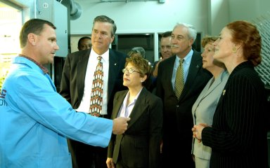 KENNEDY SPACE CENTER, FLA. -- Neil Yorio, a Dynamac scientist(left), explains the function of the KSC Space Life Sciences (SLS) Lab to a prestigious tour group: (from left) Florida Gov. Jeb Bush and his wife, Columba; NASA Administrator Sean O?Keefe and his wife, Laura; and U.S. Mint Director Henrietta Holsman Fore. The new lab is a state-of-the-art facility built for ISS biotechnology research. It was developed as a partnership between NASA-KSC and the State of Florida. The tour followed the launching ceremony at the KSC Visitor Complex for the new Florida quarter issued by the U.S. Mint. The ceremony was emceed by Center Director Jim Kennedy and included remarks by O?Keefe, Bush, Fore and Deputy Secretary of the Treasury Samuel W. Bodman.