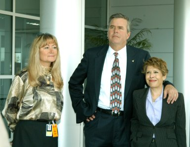 KENNEDY SPACE CENTER, FLA. -- Florida Gov. Jeb Bush and his wife, Columba (right), wait outside the KSC Space Life Sciences (SLS) Lab for a tour. At left is Debra Holliday, director of Business Development and International Affairs, Florida Spaceport Authority. The new lab is a state-of-the-art facility built for ISS biotechnology research. It was developed as a partnership between NASA-KSC and the State of Florida. The tour followed the launching ceremony at the KSC Visitor Complex for the new Florida quarter issued by the U.S. Mint. The ceremony was emceed by Kennedy and included remarks by NASA Administrator Sean O?Keefe, Gov. Jeb Bush, U.S. Mint Director Henrietta Holsman Fore and Deputy Secretary of the Treasury Samuel W. Bodman. On the tour, Gov. Bush was accompanied by NASA Administrator Sean O?Keefe and Center Director Jim Kennedy and their wives.