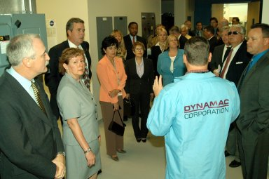 KENNEDY SPACE CENTER, FLA. -- Neil Yorio, a Dynamac scientist (right), explains the function of the KSC Space Life Sciences (SLS) Lab to a prestigious tour group. From left are NASA Administrator Sean O?Keefe and his wife, Laura; Florida Gov. Jeb Bush; Bernadette Kennedy, wife of the Center Director (CD); Columba Bush, wife of the governor; behind Mrs. Bush, former astronaut Winston Scott; and third from right, CD Jim Kennedy. The new lab is a state-of-the-art facility built for ISS biotechnology research. It was developed as a partnership between NASA-KSC and the State of Florida. The tour followed the launching ceremony at the KSC Visitor Complex for the new Florida quarter issued by the U.S. Mint. The ceremony was emceed by Kennedy and included remarks by O?Keefe, Bush, U.S. Mint Director Henrietta Holsman Fore and Deputy Secretary of the Treasury Samuel W. Bodman.