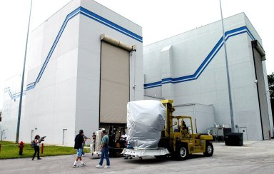 KENNEDY SPACE CENTER, FLA. - The MESSENGER (Mercury Surface, Space Environment, Geochemistry and Ranging) spacecraft arrives at the nonhazardous payload processing facility at Astrotech Space Operations in Titusville, Fla., after leaving the hazardous processing facility, where it has been since arrival March 10. The remainder of its final assembly and testing will be completed in the new facility. The spacecraft will return to the hazardous processing facility when ready for fueling, spin balance testing and mating to the upper stage. MESSENGER is scheduled to launch no earlier than July 30 from Cape Canaveral Air Force Station. MESSENGER is a scientific investigation of the planet Mercury, the least explored terrestrial planet. Understanding Mercury and how it was formed is essential to understanding the other terrestrial planets and their evolution. The MESSENGER mission will orbit Mercury after making two flybys of the planet, using data collected during the flybys as an initial guide to perform a more focused scientific investigation of this mysterious world. The spacecraft will enter Mercury orbit in March 2011 and carry out comprehensive measurements for one full Earth year.