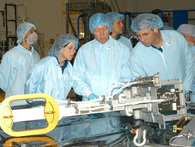 KENNEDY SPACE CENTER, FLA. - In the Space Station Processing Facility, members of several Space Shuttle mission crews get a close look at the Video Stanchion Support Assembly (VSSA) that will fly on STS-114 (Logistics Flight 1). From left are STS-118 Mission Specialist Barbara Morgan, STS-116 Mission Specialist Christer Fuglesang (European Space Agency), and STS-118 Mission Specialists Scott Parazynski and Dafydd Williams (Canadian Space Agency). The crews are at KSC for equipment familiarization.