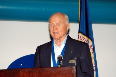 """KENNEDY SPACE CENTER, FLA. -- At the Kennedy Space Center Visitor Complex, former NASA astronaut John H. Glenn Jr. participates in the 2004 U.S. Astronaut Hall of Fame induction ceremony. He is introducing inductee and fellow Ohioan Kathryn D. Sullivan, the first American woman to walk in space. Also chosen for this honor in 2004 are Richard O. Covey, commander of the Hubble Space Telescope repair mission; Frederick D. Gregory, the first African-American to command a space mission; Norman E. Thagard, the first American to occupy Russia's Mir space station; and the late Francis R. """"Dick"""" Scobee, commander of the ill-fated 1986 Challenger mission. The U.S. Astronaut Hall of Fame opened in 1990 to provide a place where space travelers could be remembered for their participation and accomplishments in the U.S. space program. To be eligible for induction, an individual must have been a U.S. citizen, a NASA astronaut, and out of the active astronaut corps at least five years. The five inductees join 52 previously honored astronauts from the ranks of the Gemini, Apollo, Skylab, Apollo-Soyuz, and Space Shuttle programs."""