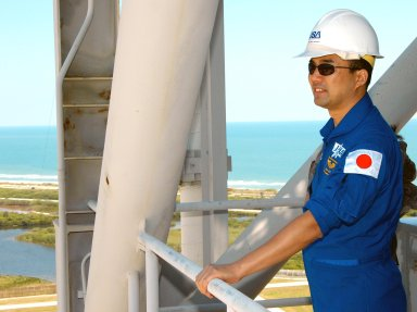KENNEDY SPACE CENTER, FLA. -- From an upper level of the Fixed Service Structure on Launch Pad 39A, STS-114 Mission Specialist Soichi Noguchi, who represents the Japanese Aerospace and Exploration Agency, looks at the surrounding area. Beyond the pad is the aqua blue Atlantic Ocean. The STS-114 mission is Logistics Flight 1, which is scheduled to deliver supplies and equipment plus the external stowage platform to the International Space Station.