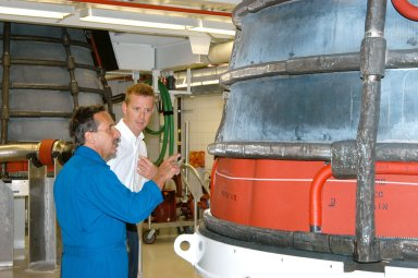 KENNEDY SPACE CENTER, FLA. -- STS-114 Mission Specialist Charles Camarda and Boeing Tech Operations? Team Manager Matthew McClelland look at an engine on a visit to the Space Shuttle Main Engine Shop at KSC. He and other crew members touring several areas on the Center. The STS-114 mission is Logistics Flight 1, which is scheduled to deliver supplies and equipment plus the external stowage platform to the International Space Station.