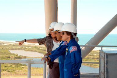 KENNEDY SPACE CENTER, FLA. -- From an upper level of the Fixed Service Structure on Launch Pad 39A, STS-114 Mission Specialists Charles Camarda (center) and Wendy Lawrence (right) look at the surrounding area. Beyond the pad is the aqua blue Atlantic Ocean. The STS-114 mission is Logistics Flight 1, which is scheduled to deliver supplies and equipment plus the external stowage platform to the International Space Station.