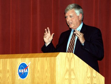 KENNEDY SPACE CENTER, FLA. -- Center Director James W. Kennedy addresses KSC employees assembled in the Training Auditorium for a Culture Change Process All Hands Meeting. The purpose of the meeting was for employees to gain further insight into the Agency?s Vision for Space Exploration and the direction cultural change will take at KSC in order to assume its role within this vision. Other participants included Jim Jennings, Deputy Associate Administrator for Institutions and Asset Management; Lynn Cline, Deputy Associate Administrator for Space Flight; Bob Sieck, former Director of Space Shuttle Processing at KSC; and Jim Wetherbee, astronaut and Technical Assistant to the Director of Safety and Mission Assurance at Johnson Space Center. Following their remarks, members of the panel entertained questions and comments from the audience.
