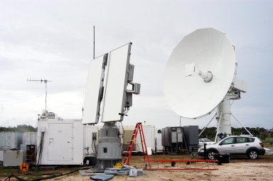 KENNEDY SPACE CENTER, FLA. - An X-band (left) and a C-band radar antenna are prepared to observe the MESSENGER (Mercury Surface, Space Environment, Geochemistry and Ranging) launch. The antennas are on loan to KSC from the USNS Pathfinder, a U.S. Navy instrumentation ship. They have been installed at site north of Haulover Canal where the National Center for Atmospheric Research previously had a radar for thunderstorm research. NASA is evaluating the pair of radars for their ability to observe possible debris coming from the Space Shuttle during launch, part of NASA?s initiative to return the Space Shuttle to flight.