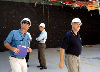 KENNEDY SPACE CENTER, FLA. - Looking at damage inside the hurricane-ravaged Thermal Protection System Facility are KSC Director of Spaceport Services Scott Kerr (left) and NASA Associate Administrator of Space Operations Mission Directorate William Readdy (right). The TPSF, which creates the TPS tiles, blankets and all the internal thermal control systems for the Space Shuttles, is almost totally unserviceable at this time after losing approximately 35 percent of its roof during Hurricane Frances, which blew across Central Florida Sept. 4-5. Readdy and NASA Administrator Sean O?Keefe are visiting KSC to survey the damage sustained by KSC facilities from the hurricane. The Labor Day storm also caused significant damage to the Vehicle Assembly Building and Processing Control Center. Additionally, the Operations and Checkout Building, Vertical Processing Facility, Hangar AE, Hangar S and Hangar AF Small Parts Facility each received substantial damage. However, well-protected and unharmed were NASA?s three Space Shuttle orbiters - Discovery, Atlantis and Endeavour - along with the Shuttle launch pads, all of the critical flight hardware for the orbiters and the International Space Station, and NASA?s Swift spacecraft that is awaiting launch in October.