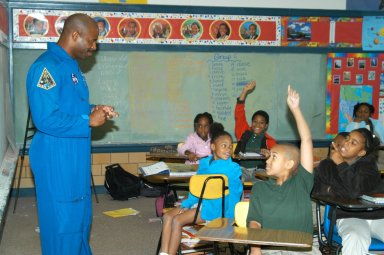 KENNEDY SPACE CENTER, FLA. - At University Community Academy in Atlanta, a NASA Explorer School, astronaut Leland Melvin talks to students. Melvin accompanied KSC Deputy Director Dr. Woodrow Whitlow Jr., who was visiting the school to share the vision for space exploration with the next generation of explorers. Whitlow talked with students about our destiny as explorers, NASA?s stepping stone approach to exploring Earth, the Moon, Mars and beyond, how space impacts our lives, and how people and machines rely on each other in space. Melvin talked about the importance of teamwork and what it takes for mission success.