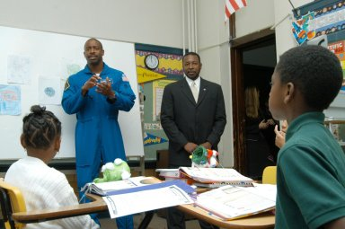 KENNEDY SPACE CENTER, FLA. - At University Community Academy in Atlanta, a NASA Explorer School, astronaut Leland Melvin talks to students. Melvin accompanied KSC Deputy Director Dr. Woodrow Whitlow Jr. (right), who was visiting the school to share the vision for space exploration with the next generation of explorers. Whitlow talked with students about our destiny as explorers, NASA?s stepping stone approach to exploring Earth, the Moon, Mars and beyond, how space impacts our lives, and how people and machines rely on each other in space. Melvin talked about the importance of teamwork and what it takes for mission success.