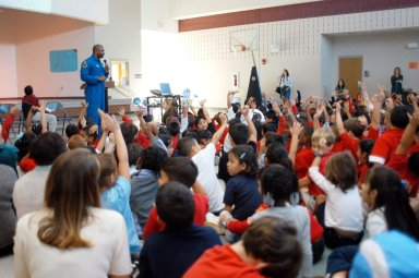 KENNEDY SPACE CENTER, FLA. - Astronaut Leland Melvin talks and interacts with students at Gainesville Elementary School, a NASA Explorer School in Gainesville, Ga. Melvin joined Jim Jennings, deputy associate administrator for Institutions and Asset Management at NASA Headquarters, on the visit to the school to share the new vision for space exploration with the next generation of explorers. Also accompanying Jennings was KSC Deputy Director Dr. Woodrow Whitlow Jr., who talked with students about our destiny as explorers, NASA?s stepping stone approach to exploring Earth, the Moon, Mars and beyond, how space impacts our lives, and how people and machines rely on each other in space. Melvin talked about the importance of teamwork and what it takes for mission success.