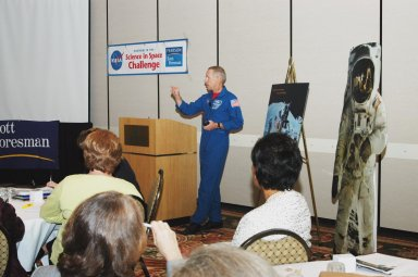 """KENNEDY SPACE CENTER, FLA. - NASA astronaut Patrick Forrester addresses a group of educators assembled for the kickoff of """"The Science in Space Challenge"""" at the Doubletree Hotel in Orlando, Fla. The national challenge program is sponsored by NASA and Pearson Scott Foresman, publisher of pre-K through grade six educational books. To participate in the challenge, teachers may submit proposals, on behalf of their students, for a science and technology investigation. Astronauts will conduct the winning projects on a Space Shuttle mission or on the International Space Station, while teachers and students follow along via television or the Web. For more information about the announcement, see the news release at http://www.nasa.gov/home/hqnews/2004/oct/HQ_04341_publication.html."""