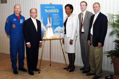 """KENNEDY SPACE CENTER, FLA. - From left, NASA astronaut Patrick Forrester; Paul McFall, president, Pearson Scott Foresman; Dr. Adena Williams Loston, NASA chief education officer; James Lippe, science product manager, Pearson Scott Foresman; and Carl Benoit, senior national science consultant, Pearson Scott Foresman, participate in the unveiling of """"The Science in Space Challenge"""" at the Doubletree Hotel in Orlando, Fla. The national challenge program is sponsored by NASA and Pearson Scott Foresman, publisher of pre-K through grade six educational books. To participate in the challenge, teachers may submit proposals, on behalf of their students, for a science and technology investigation. Astronauts will conduct the winning projects on a Space Shuttle mission or on the International Space Station, while teachers and students follow along via television or the Web. For more information about the announcement, see the news release at http://www.nasa.gov/home/hqnews/2004/oct/HQ_04341_publication.html."""
