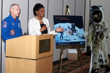 """KENNEDY SPACE CENTER, FLA. - NASA astronaut Patrick Forrester (left) and Dr. Adena Williams Loston, NASA chief education officer, address a group of educators assembled for the kickoff of """"The Science in Space Challenge"""" at the Doubletree Hotel in Orlando, Fla. The national challenge program is sponsored by NASA and Pearson Scott Foresman, publisher of pre-K through grade six educational books. To participate in the challenge, teachers may submit proposals, on behalf of their students, for a science and technology investigation. Astronauts will conduct the winning projects on a Space Shuttle mission or on the International Space Station, while teachers and students follow along via television or the Web. For more information about the announcement, see the news release at http://www.nasa.gov/home/hqnews/2004/oct/HQ_04341_publication.html."""