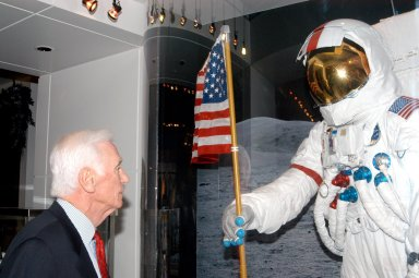 KENNEDY SPACE CENTER, FLA. - Apollo 17 Commander Gene Cernan looks at the Moon landing display in the new Kennedy Space Center Store at Orlando International Airport. NASA?s Kennedy Space Center Director Jim Kennedy and Apollo 17 Commander Gene Cernan participated in the grand opening ceremony. The store will help educate millions of airport visitors about America?s space program and the Vision for Space Exploration. The store is operated by Kennedy Space Center Visitor Complex concessionaire Delaware North Parks and Resorts.