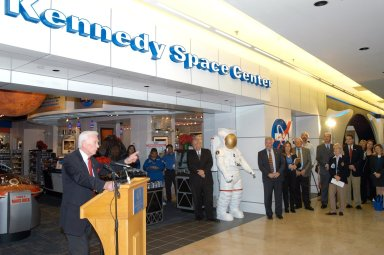 KENNEDY SPACE CENTER, FLA. - Apollo 17 Commander Gene Cernan (left) holds the attention of guests at the grand opening ceremony of the new Kennedy Space Center Store at Orlando International Airport. The store will help educate millions of airport visitors about America?s space program and the Vision for Space Exploration. The store is operated by Kennedy Space Center Visitor Complex concessionaire Delaware North Parks and Resorts.