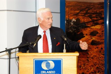 KENNEDY SPACE CENTER, FLA. - Apollo 17 Commander Gene Cernan holds the attention of guests at the grand opening ceremony of the new Kennedy Space Center Store at Orlando International Airport. The store will help educate millions of airport visitors about America?s space program and the Vision for Space Exploration. The store is operated by Kennedy Space Center Visitor Complex concessionaire Delaware North Parks and Resorts.