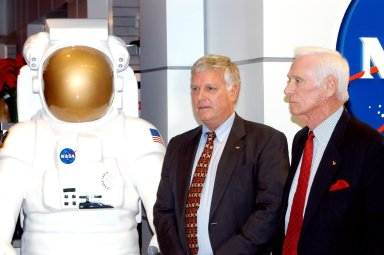 KENNEDY SPACE CENTER, FLA. - Center Director Jim Kennedy (left) and Apollo 17 Commander Gene Cernan stand next to a display of an astronaut at the new Kennedy Space Center Store at Orlando International Airport. NASA?s Kennedy Space Center Director Jim Kennedy and Apollo 17 Commander Gene Cernan participated in the grand opening ceremony of the store that will help educate millions of airport visitors about America?s space program and the Vision for Space Exploration. The store is operated by Kennedy Space Center Visitor Complex concessionaire Delaware North Parks and Resorts.