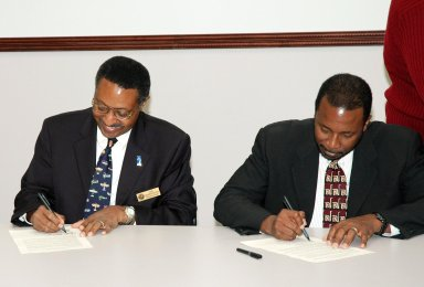 KENNEDY SPACE CENTER, FLA. - Leaders of prominent Florida space organizations convened at the Florida Space Authority campus in Cape Canaveral to sign a memorandum of agreement with the Space Foundation to launch the first ?Florida Space? conference. Retired Navy Capt. Winston E. Scott (left), executive director of the Florida Space Authority, and Dr. Woodrow Whitlow Jr., deputy director of the Kennedy Space Center, sign copies of the agreement for their respective organizations. Others present to sign the agreement are Dr. James W. Johnson, chairman of the Canaveral Council of Technical Societies; Col. Mark H. Owen, commander of the 45th Space Wing at Patrick Air Force Base; and Elliot G. Pulham, president and chief executive officer of the Space Foundation. The conference will combine and build on the best features of previous Florida space events including Space Congress and the Cape Canaveral Spaceport Symposium. Both will be retired now in favor of this new event to be held annually and operated by the Space Foundation. Florida Space 2005 will be presented in November 2005.