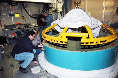 KENNEDY SPACE CENTER, FLA. - In the mobile service tower on Pad 17-B, Cape Canaveral Air Force Station , Fla., the Boeing Delta II interstage adapter is being removed. The interstage adapter was found to be faulty during a review of launch vehicle hardware. It will be replaced, and the second stage previously removed will be re-installed within a few days. Launch of Deep Impact is now scheduled no earlier than Jan. 12.
