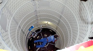 KENNEDY SPACE CENTER, FLA. - In the mobile service tower on Pad 17-B, Cape Canaveral Air Force Station , Fla., a technician works inside the Boeing Delta II interstage adapter, which is being removed. The interstage adapter was found to be faulty during a review of launch vehicle hardware. It will be replaced, and the second stage previously removed will be re-installed within a few days. Launch of Deep Impact is now scheduled no earlier than Jan. 12.