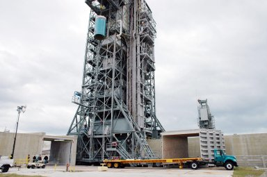 KENNEDY SPACE CENTER, FLA. - On Pad 17-B, Cape Canaveral Air Force Station , Fla., Boeing Delta II interstage adapter is seen being lowered toward the pad. The interstage adapter was found to be faulty during a review of launch vehicle hardware. It will be replaced, and the second stage previously removed will be re-installed within a few days. Launch of Deep Impact is now scheduled no earlier than Jan. 12.