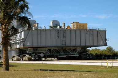 KENNEDY SPACE CENTER, FLA. - The Crawler Transporter that will move Space Shuttle Discovery to the launch pad for Return to Flight demonstrates its readiness for weight bearing by carrying an unloaded 8,230,000-pound Mobile Launch Platform along the crawlerway. Its first road test on Jan. 21, following the replacement of all its shoes, was a success. Cracks appeared in the crawlers' shoes in recent years, spurring a need for replacement. The new manufacturer, in Duluth, Minn., has improved the design for a safe Return to Flight and use through the balance of the Space Shuttle Program. Each crawler has 456 shoes, 57 per belt (8 belts in all). Each shoe weighs 2,200 pounds.