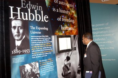 KENNEDY SPACE CENTER, FLA. - Dr. Woodrow Whitlow Jr., deputy director of Kennedy Space Center, looks at an exhibit of astronomer Edwin Hubble at the Museum of Science and Industry (MOSI) in Tampa. Whitlow was at MOSI to view the space exhibits Space: A Journey to Our Future, an extraordinary, interactive exhibition designed to entertain, educate and inspire; and SPACE STATION, the first cinematic journey to the International Space Station (ISS), where audiences can experience for themselves life in zero gravity aboard the new station.